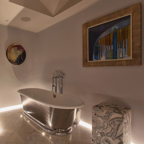 Contemporary bathroom low level linear LED lighting