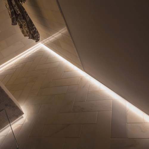 Close up of low level linear LED bathroom lighting