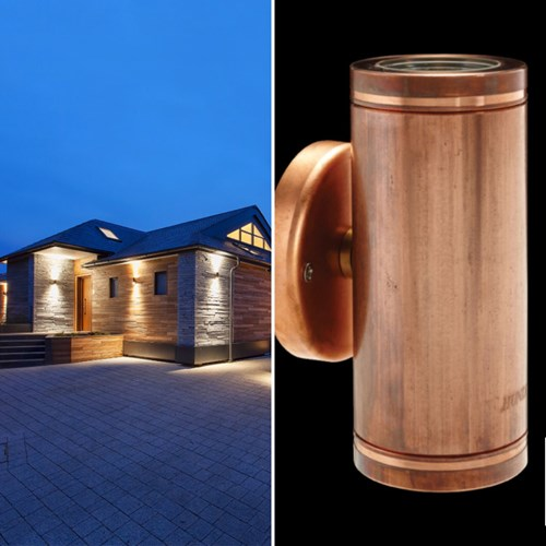 Discreet outdoor up and down LED wall lights pick out the reflief of the tiles on the walls of this house