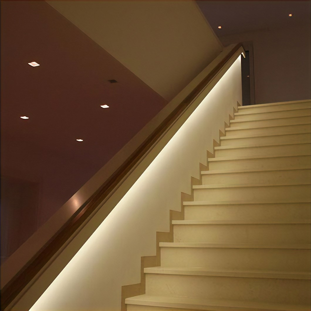 Eleni EL501 linear profile cornice installed as a contemporary handrail for stairs in a modern building
