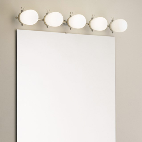 5 opaque glass bulb LED bathroom lights, installed above a bathroom mirror