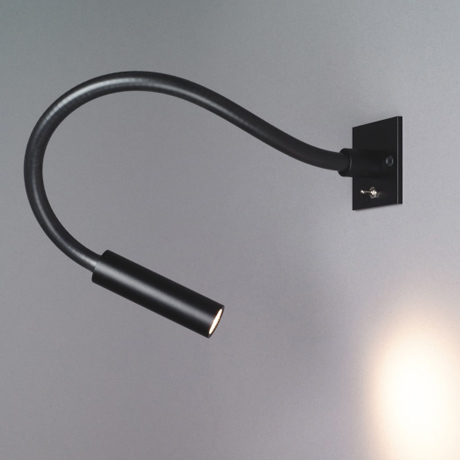 Flexible and minimal wall mounted contemporary reading light, finished in black with the on/off switch on the plate