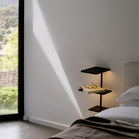 Versatile contemporary illuminated furniture, a wall mounted shelving unit with in black with backlit LEDs