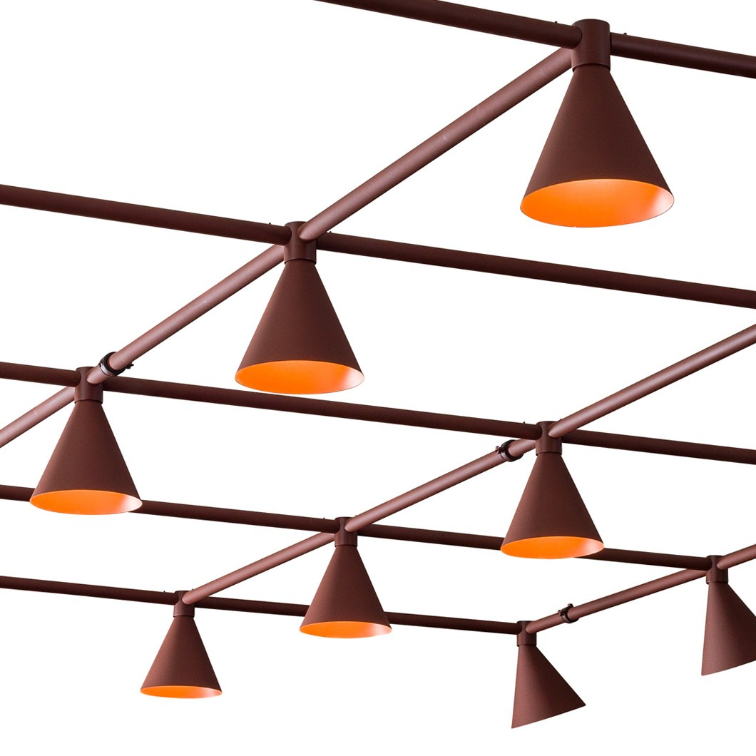Rows of conical shades from a Blond Belysning Grid Lighting System against a white background