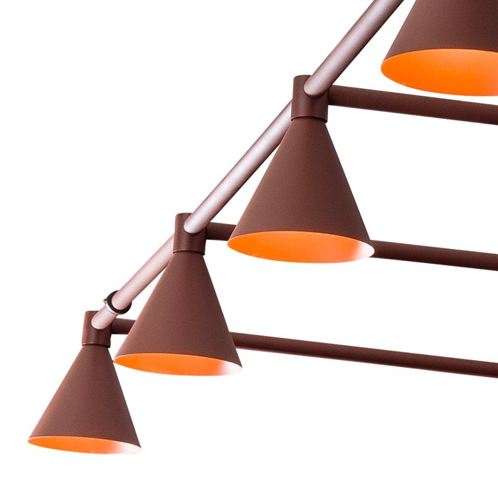 A row of 4 conical shades from a Blond Belysning Grid Lighting System on a white background