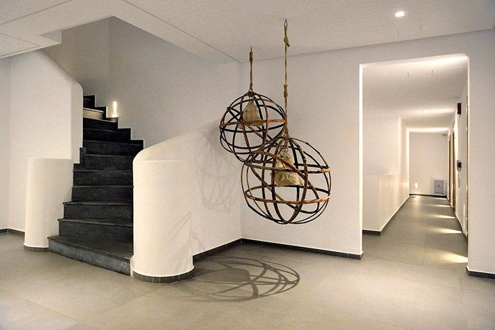 Nama Fos 15 plaster in recessed wall lights washing the floor with light in a white corridor & stairway