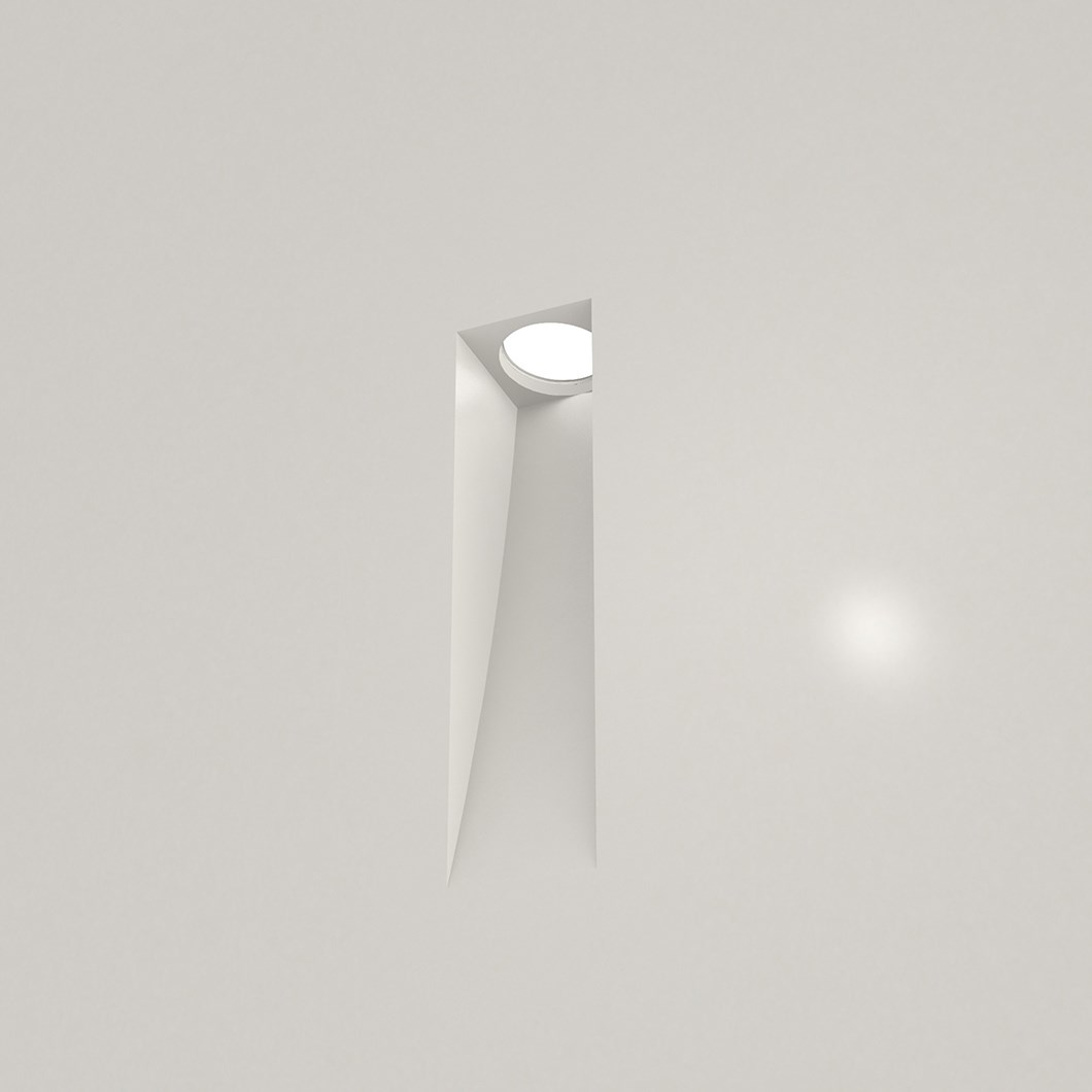 Nama Fos 15 Wall Light recessed and plastered into a plain grey wall, light switched on