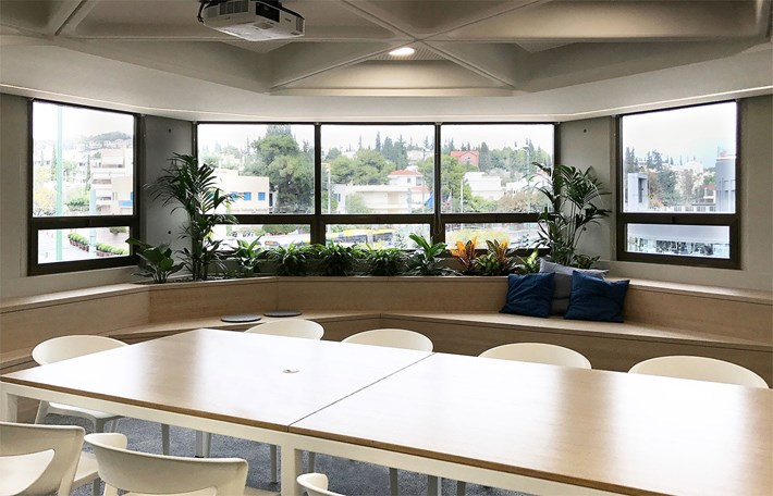 Nama Modular Fos 17 Plaster In Downlight Light installed in a contemporary meeting room in an office