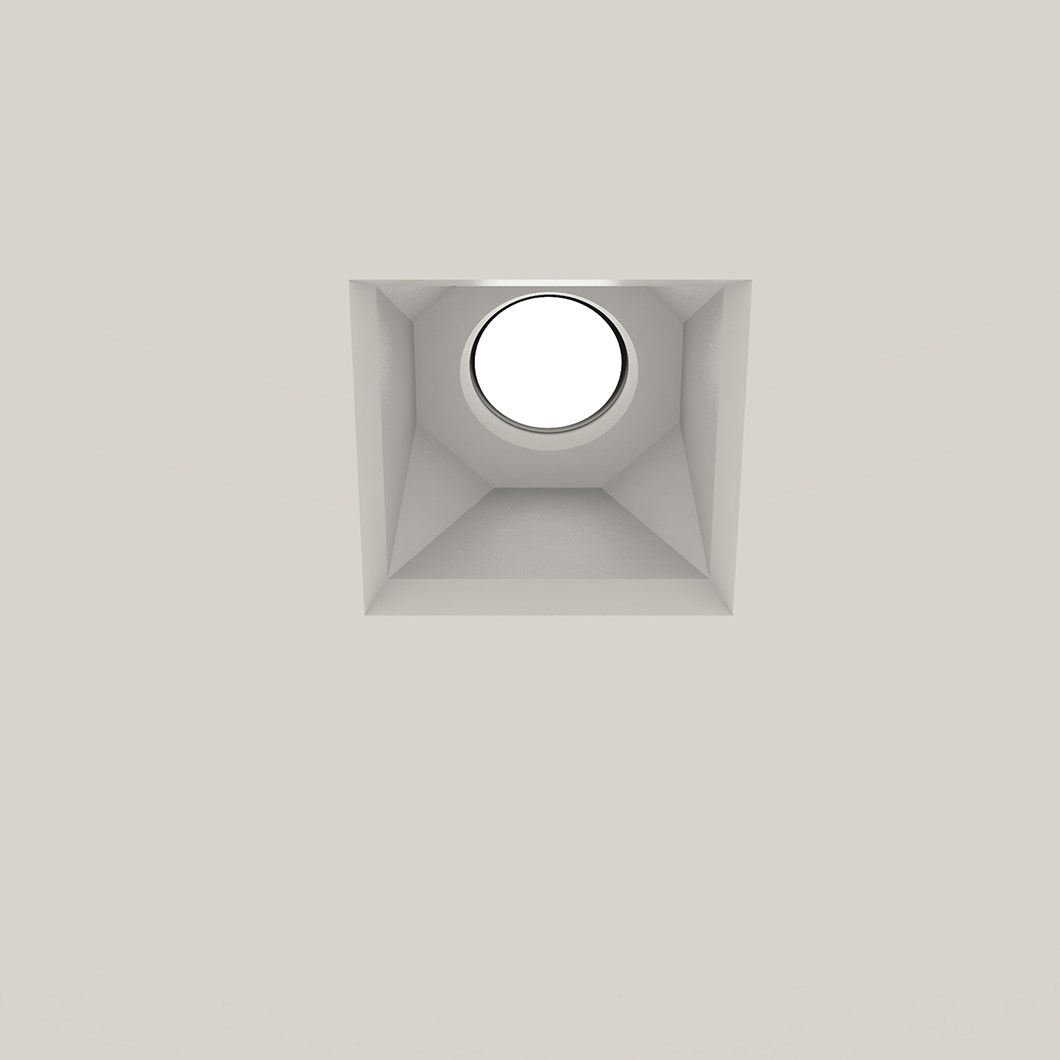 Nama Fos 21 Square Plaster In Downlight installed in a grey ceiling & switched on
