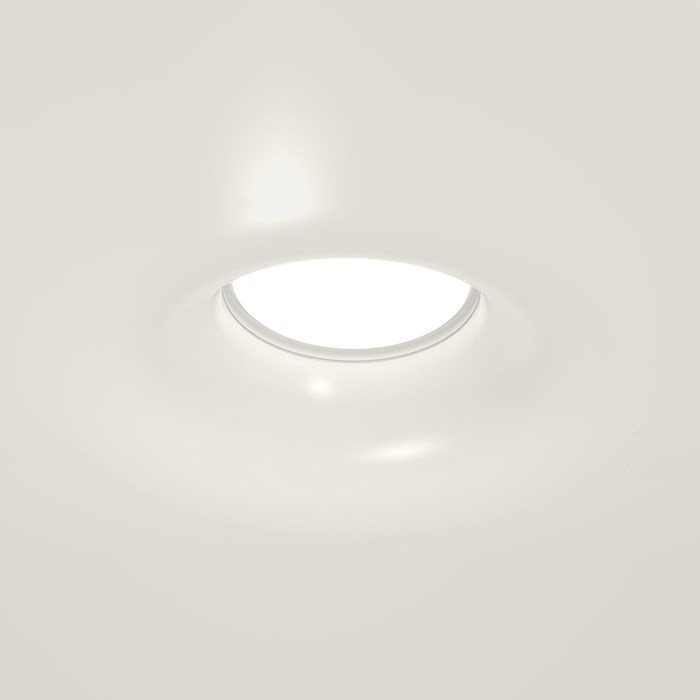 Nama Fos 22 Round Plaster In Downlight installed in a grey ceiling & switched on