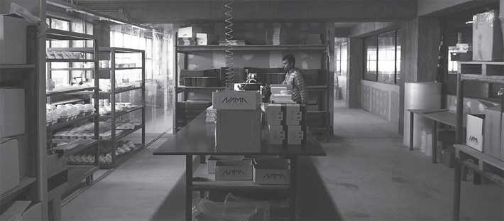 Nama factory in Greece packaging and stock area in black and white