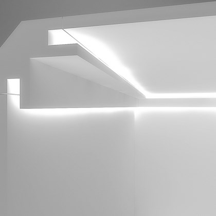CGI cross section of Eleni EL203 recessed plaster in cornice LED lighting installed into the ceiling and wall with the LED switched on