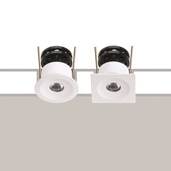 Both the round and square versions of the Flexalighting Hero 2 recessed downlight, both in white.