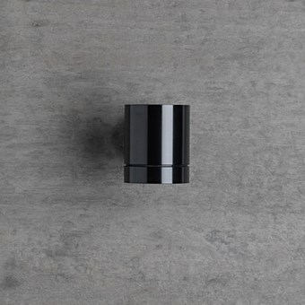 Flexalighting's Keller Wall Light in black, mounted to a grey wall.