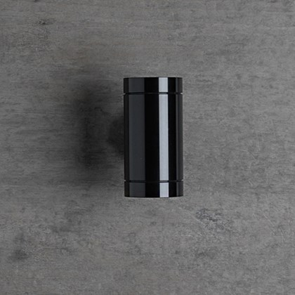 The Flexalighting Keller Double Emission wall light in black, mounted to a grey wall.