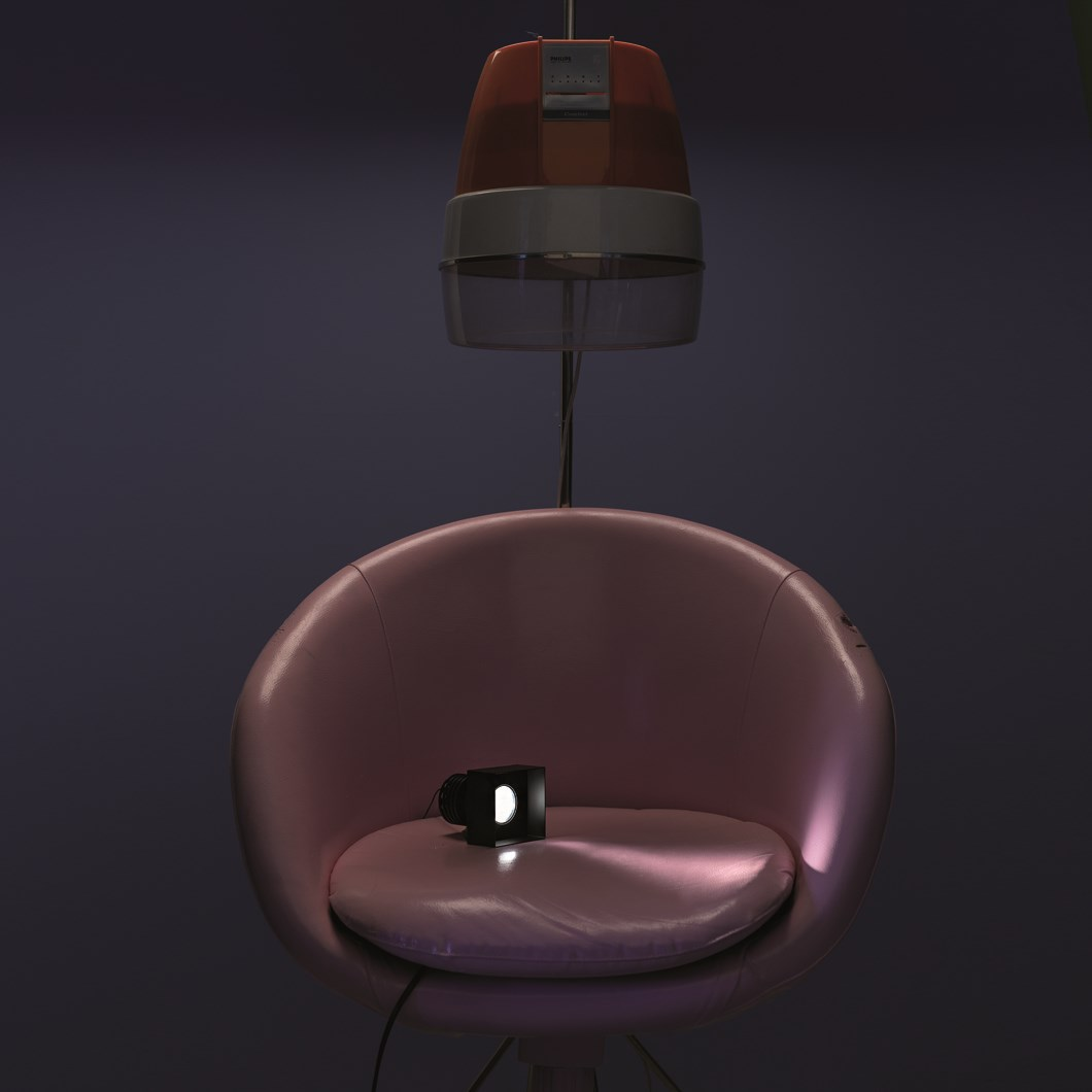 The Flexalighitng None Q10 trimless downlight lifestyle image, with the fitting on a pink chair.