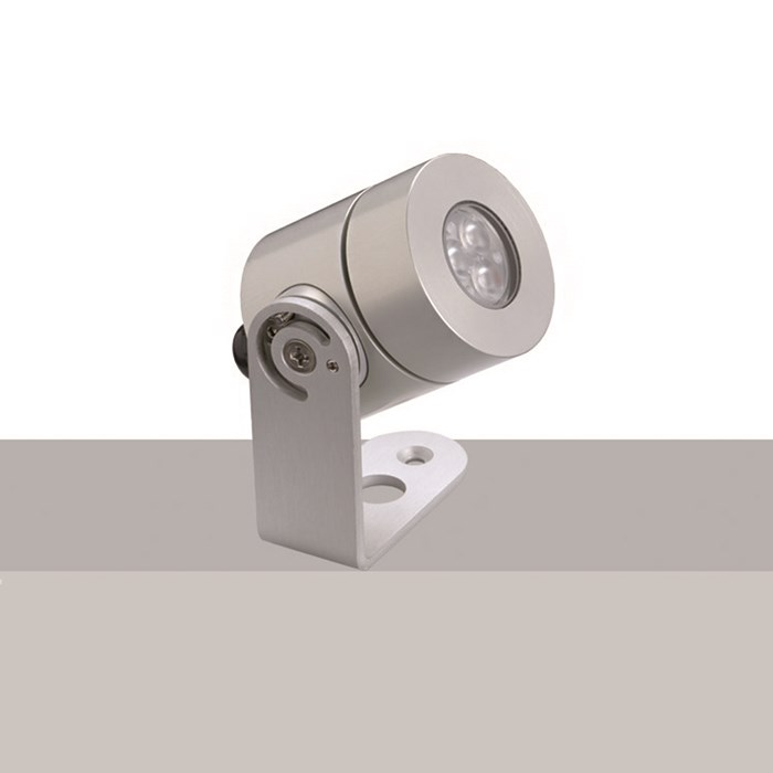 The Flexalighting Olu 6 spot light in aluminium, over a white and grey background.
