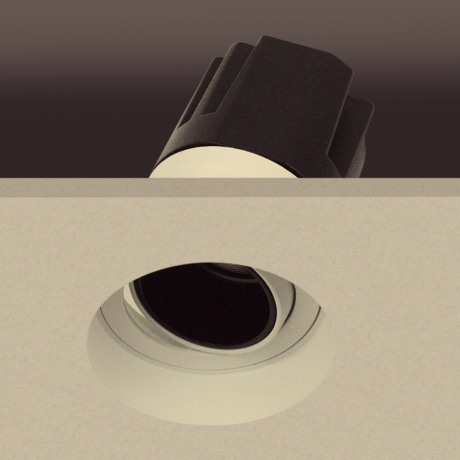 Architectural recessed directional adjustable round downlight plastered into the ceiling and showing light engine in a cutout