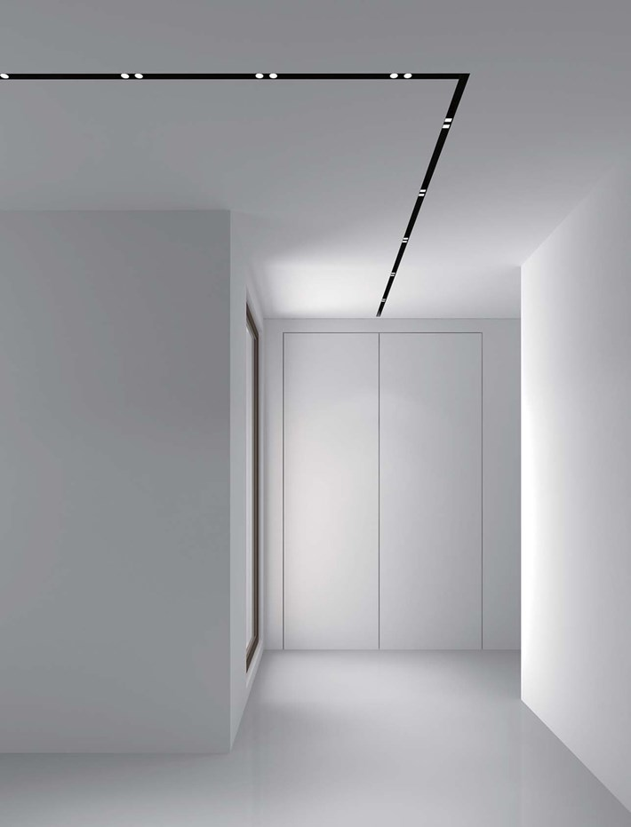 DLD Shadowline recessed track with right angle joint and twin LED spot lights in a contemporary modern hallway