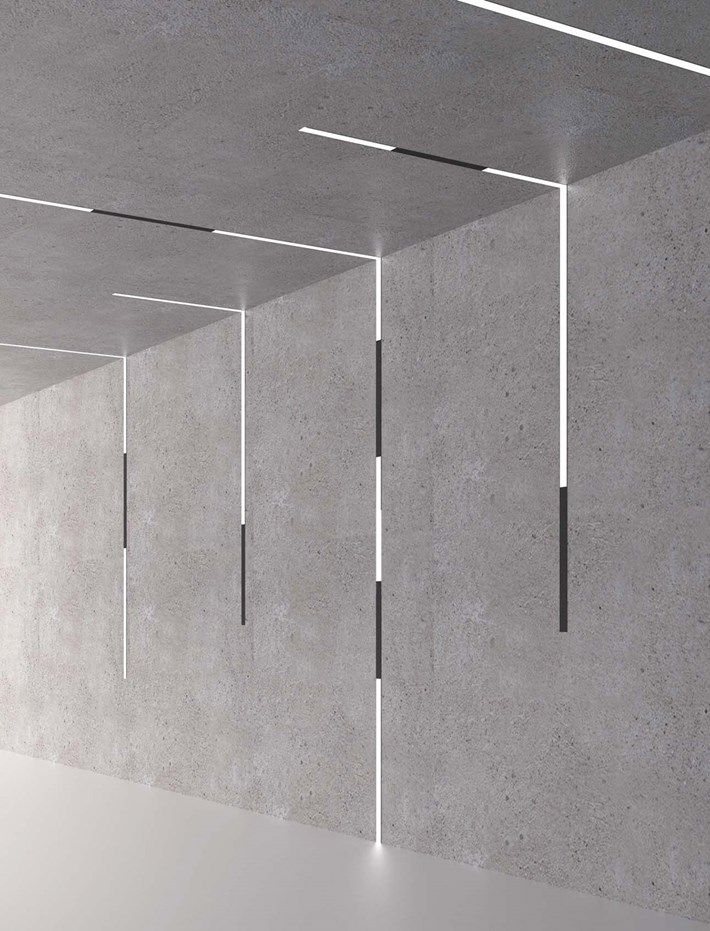 DLD Shadowline recessed track with right angle joint linking from the ceiling to the wall, using linear LED modules