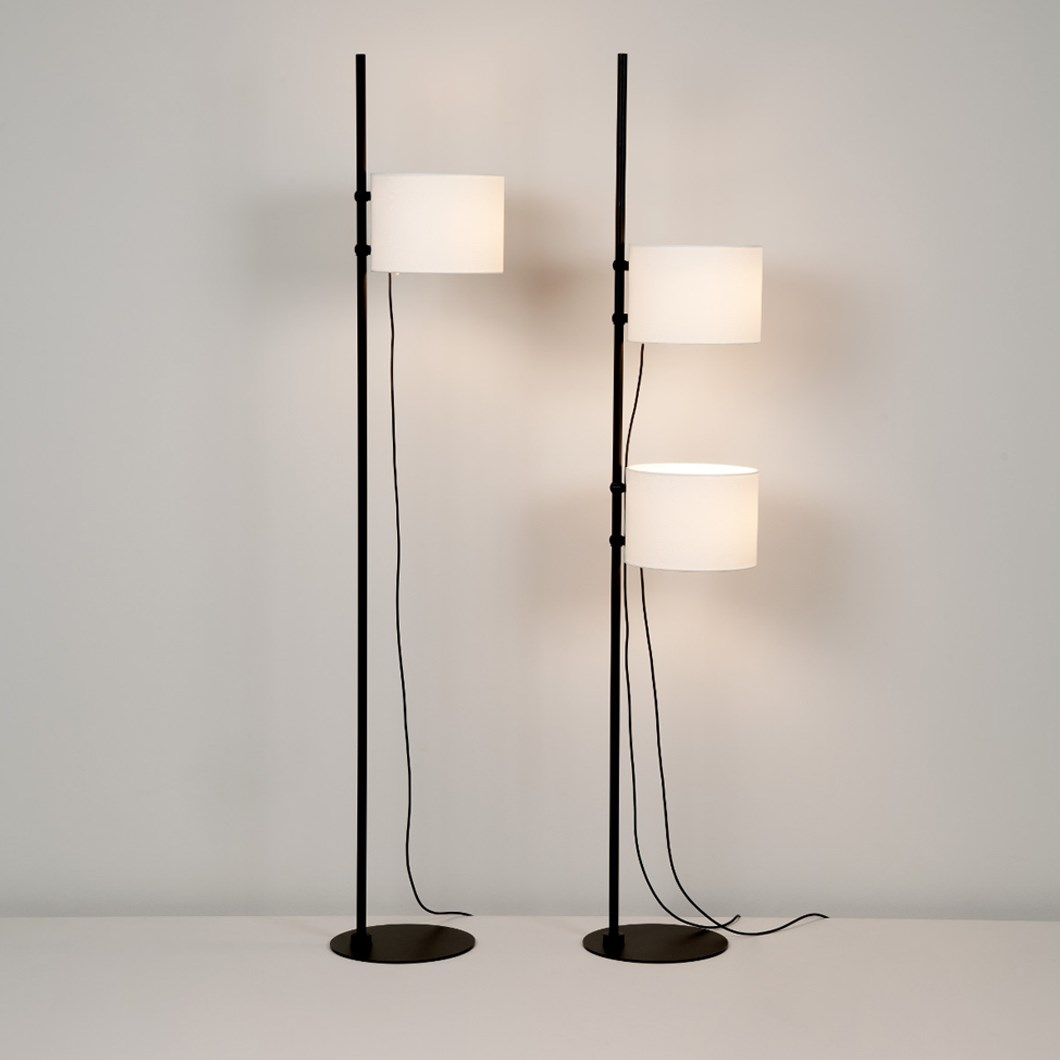 Freestanding floor lamp by Milan iluminacion in a walnut stained wood with warm led lights