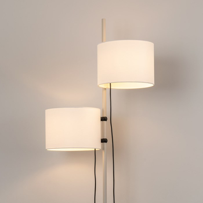 Close up shot of free standing floor lamp, oak wooden finish with adjustable height lamp shades