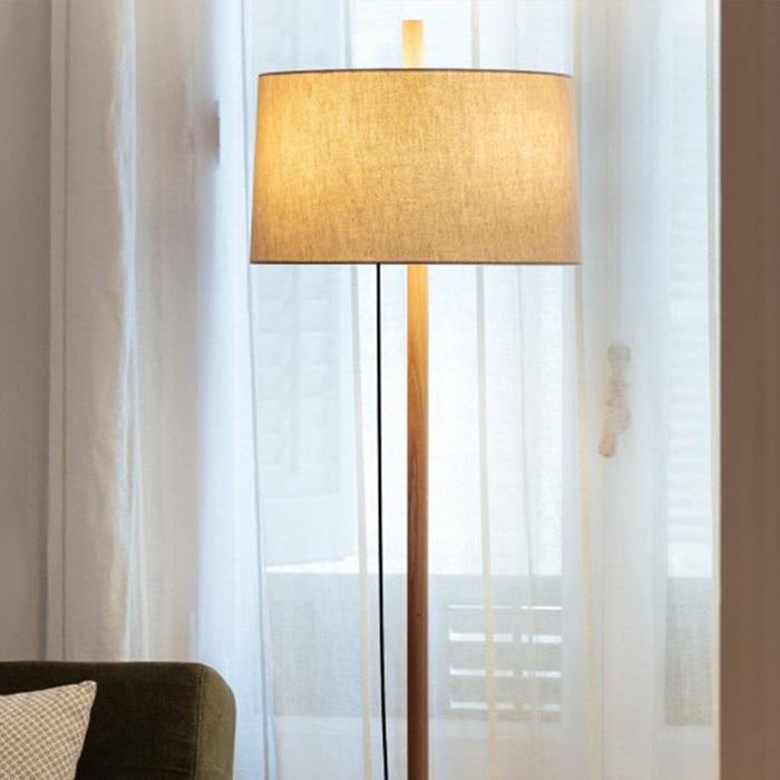 Linood light by Milan Iluminacion with a straight stand finished in oak
